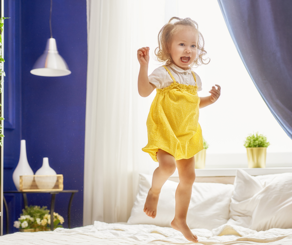 ADHD child jumping on bed