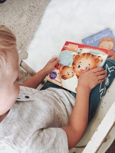 reading books about a new baby