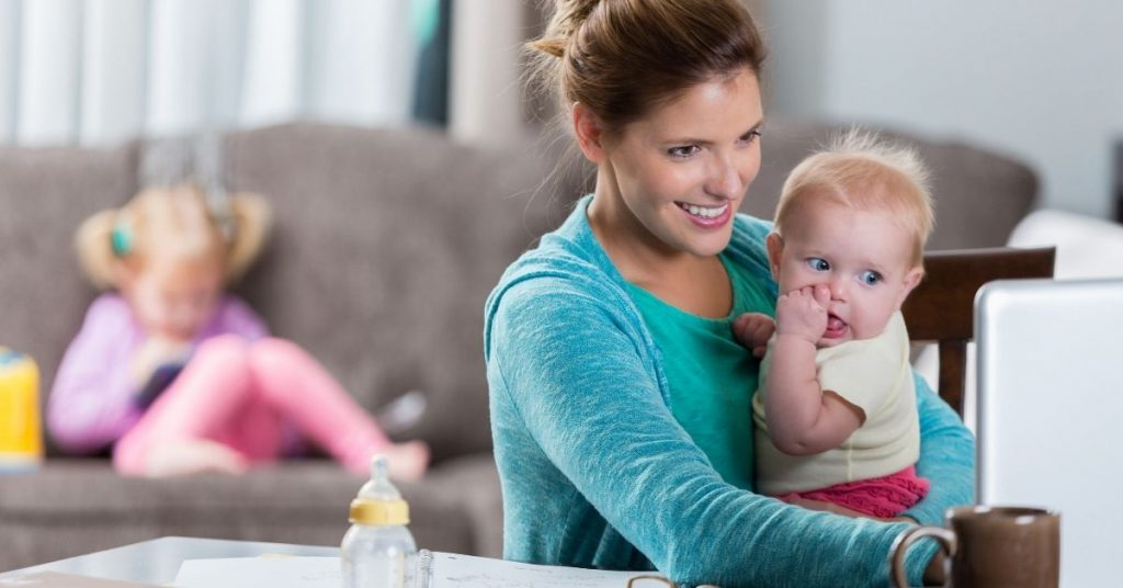 Busy working mom with her two children practicing time saving tips
