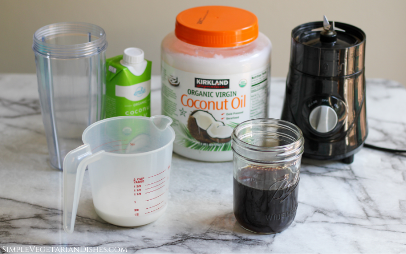 coffee, coconut oil, coconut milk, and blender on white marble table