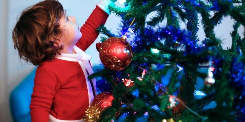 toddler stocking stuffer ideas boy hanging ornaments on tree